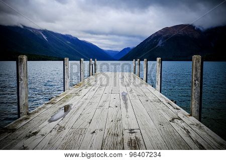 Pier Leading Into The Lake At Wairau, New Zealand