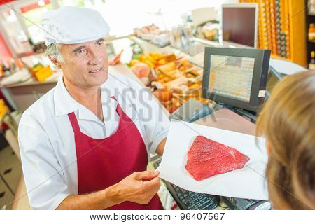 Serving a steak in a deli