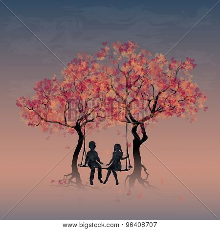 Couple on a swing between trees