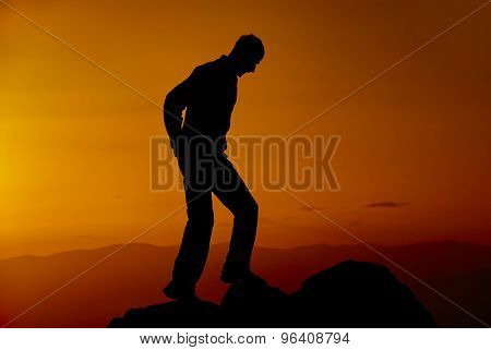 Man on the mountain in the evening