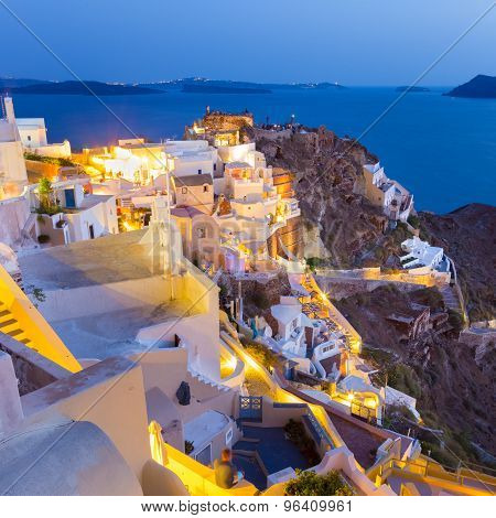 Oia village on Santorini in sunset, Greece.