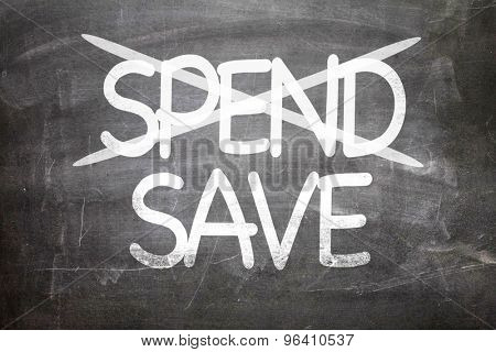 Spend Save written on a chalkboard