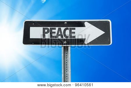 Peace direction sign with a beautiful day