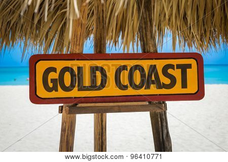 Gold Coast sign with beach background