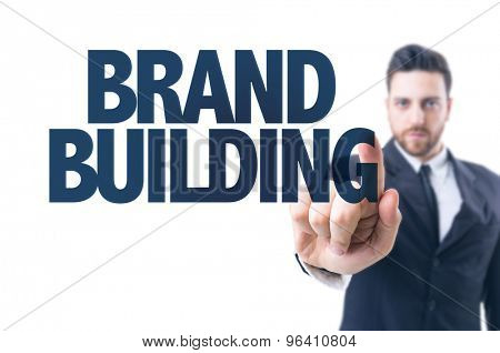 Business man pointing the text: Brand Building