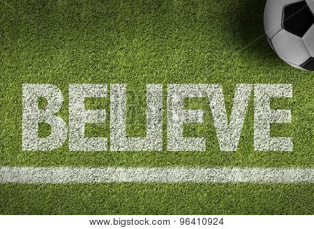 Soccer field with the text: Believe