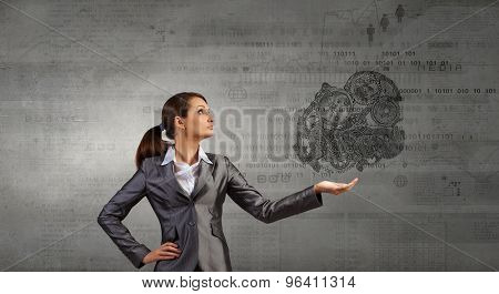 Attractive businesswoman holding in palm working gears mechanism