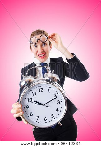 Nerd businesswoman with giant alarm clock