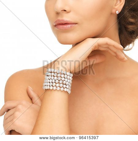 beautiful woman wearing pearl earrings and bracelet