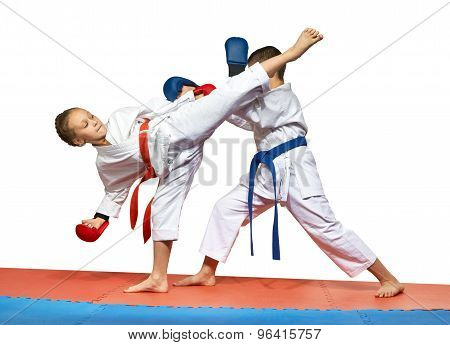 Two young athlete doing exercise paired karate