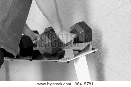 Hand Holding Dumbbell In The Gym