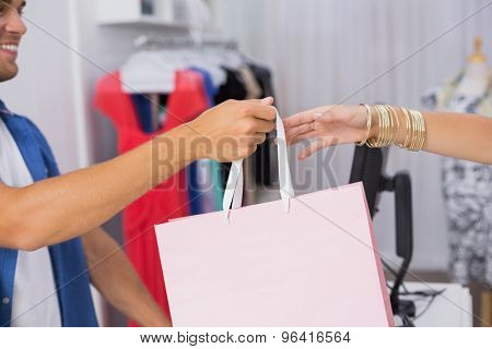 A woman taking a bag in the clothing store
