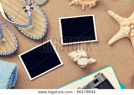 Travel and vacation photo frames and items over sea sand. Top view. Toned