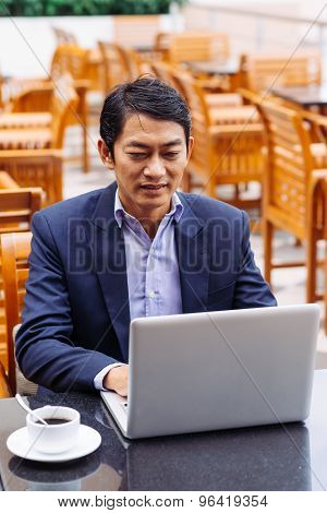 Middle-aged Asian Manager