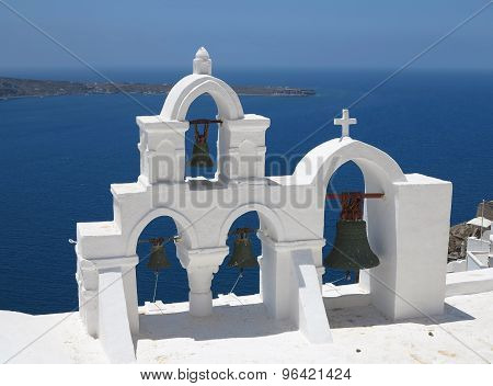 Details Of Santorini Island Greece - Beautiful Typical Church With White Belfry Blue Sea