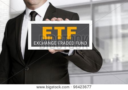 Etf Sign Is Held By Businessman Background