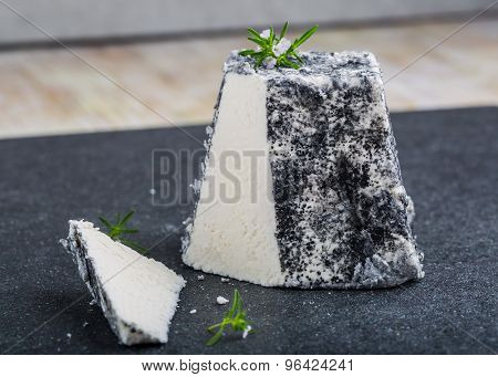 Goat Cheese Valencay On A Black Background