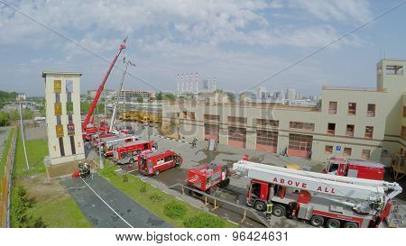 MOSCOW - MAY 29, 2015: Firemen stand near special transport in fire station at spring sunny day. Aerial view