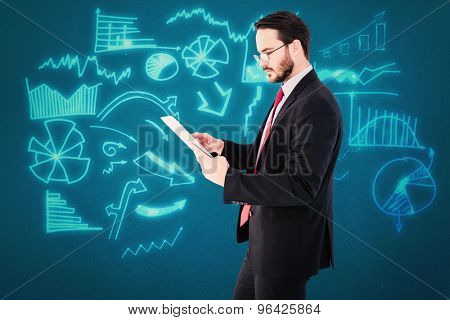 Businessman scrolling on his digital tablet against blue background