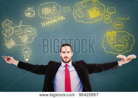 Unsmiling businessman sitting with arms outstretched against blue background