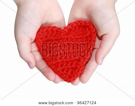 red crocheted heart in hands