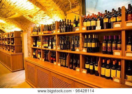 Wine Bottles In Authentic Italian Wine Cellar Interior