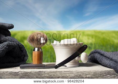 Shaving Equipment On Wood In Landscape