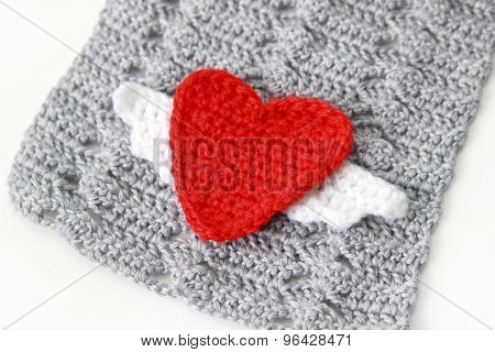 gray scarf with red crocheted heart