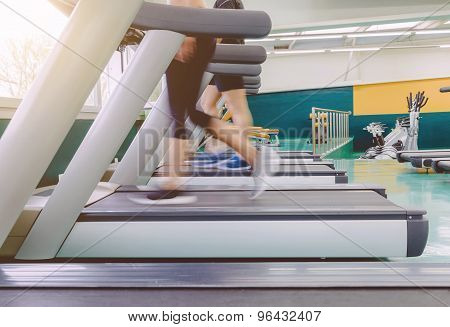 People legs in motion during a treadmill training