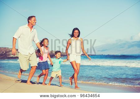 Young Happy Family Having Fun on the Beach Outdoors