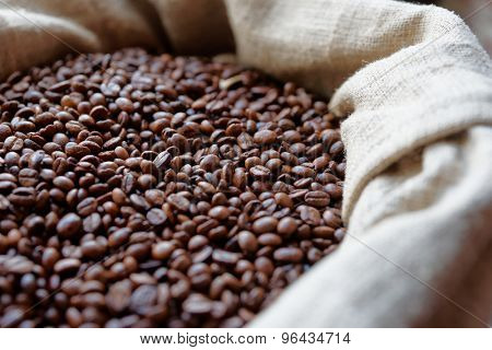 Sack of roasted coffee beans, close-up