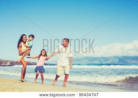 Young Happy Mixed Race Family Having Fun on the Beach Outdoors