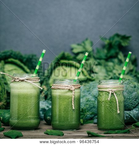 Blended Green Smoothie With Ingredients On Wooden Table