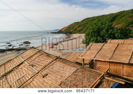 Straw hut roofs and beach view goa india