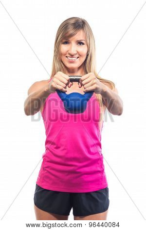 Fitness woman exercising crossfit holding kettlebell strength training biceps. isolated