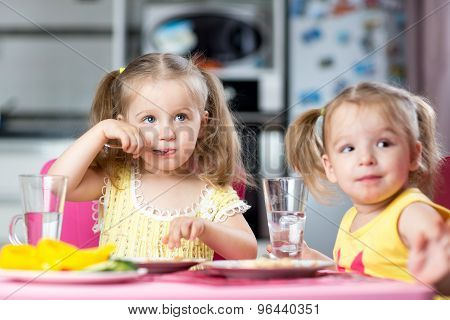 Children drinking and eating at daycare