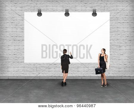 Elegant business woman looking at banner.