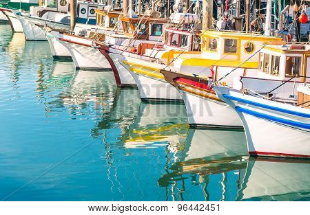 Colorful Sailing Boats At Fishermans Wharf Of San Francisco Bay - California - United States