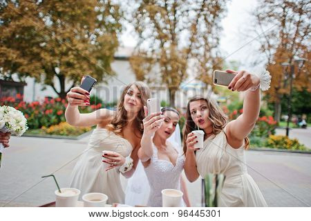 Young Bridesmaid With Bride Doing Selfie