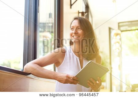 Smiling Older Woman With Tablet