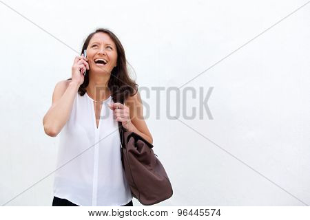 Woman Smiling With Mobile Phone And Bag