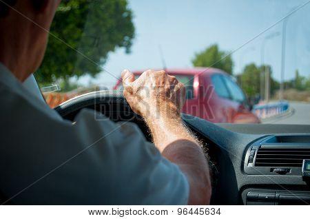 Hand Of A Senior Man Driving A Car Detail