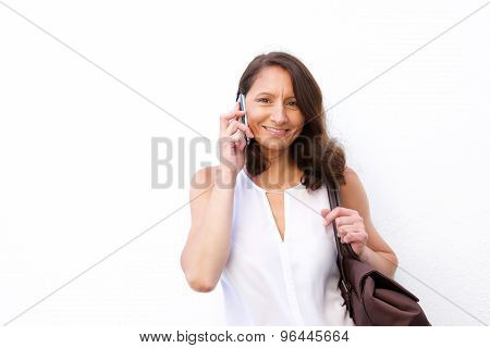 Attractive Older Woman With Bag Using Mobile Phone