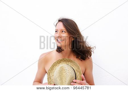 Smiling Woman Holding Hat Over Nude Body