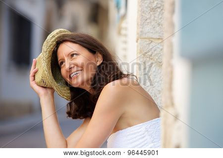 Happy Older Woman Laughing With Hat Outside