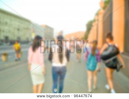 Crowd of blurred walking people in the city.