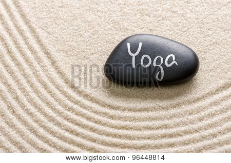 A Black Stone With The Inscription Yoga
