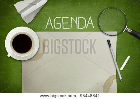 Agenda concept on blackboard with empty paper sheet