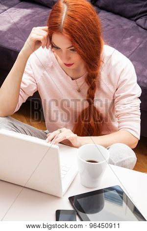 Young Woman Using Laptop In The Living Room