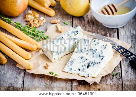 Blue Cheese Slices With Breadsticks, Nuts And Honey